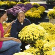 Couple buying flowers. — Stock Photo