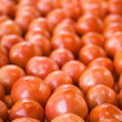 Stock Photo: Tomatoes at produce market.