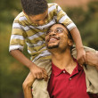 Father carrying son — Stock Photo