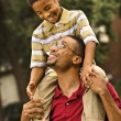 Dad carrying son — Stock Photo