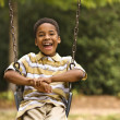 Stock Photo: Boy on swing
