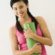 Woman with exercise mat — Stock Photo