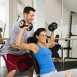 Woman lifting weights — Stock Photo #9309678