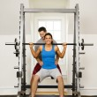 Woman lifting weights — Stock Photo #9309702