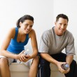 Male and female sitting smiling. — Stock Photo