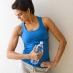 Постер, плакат: Woman flexing muscle