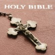 Crucifix on Bible. - Stock Photo