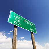 Lost Springs road sign. — Stock Photo