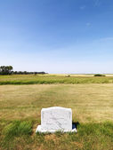 Headstone in field. — Stock Photo