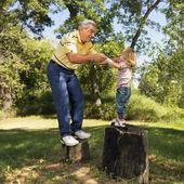 Senior man and child playing. — Stock Photo