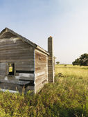 Old house in field. — Stock Photo