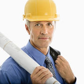 Businessman in hard hat. — Stock Photo