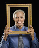 Man in picture frame. — Stock Photo