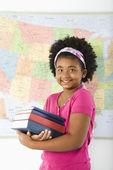 Schoolgirl with books. — Foto de Stock