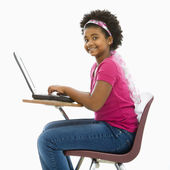 Schoolgirl on laptop. — Stock Photo