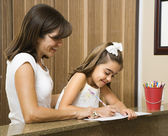 Mom helping daughter. — Stock Photo