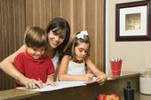 Family doing homework. — Stock Photo