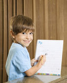Boy showing homework. — Foto de Stock