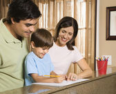 Family with homework. — Stock Photo