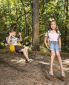 Kids on swing set. — Stock Photo