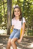 Girl on swing. — Stock Photo