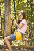 Girl swinging. — Stock Photo