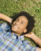 Man lying in grass. — Stock Photo