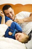 Dad tickling child. — Stock Photo