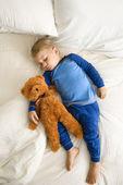 Toddler sleeping with bear. — Stock Photo