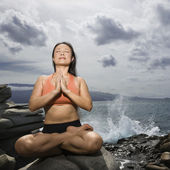 Woman practising yoga — Stock Photo