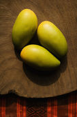 Three wooden mangoes. — Stock Photo