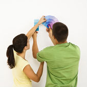 Couple choosing home color. — Stock Photo
