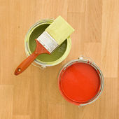 Paint cans and brush. — Stock Photo