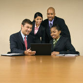 Businesspeople with computer. — Stock Photo