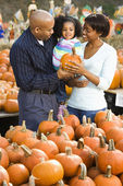 Family buying pumpkin. — Stock Photo