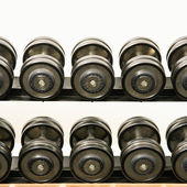 Barbells on rack — Stock Photo