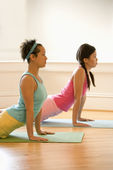 Women doing yoga — Stock Photo