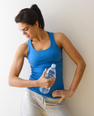 Woman flexing muscle — Foto Stock
