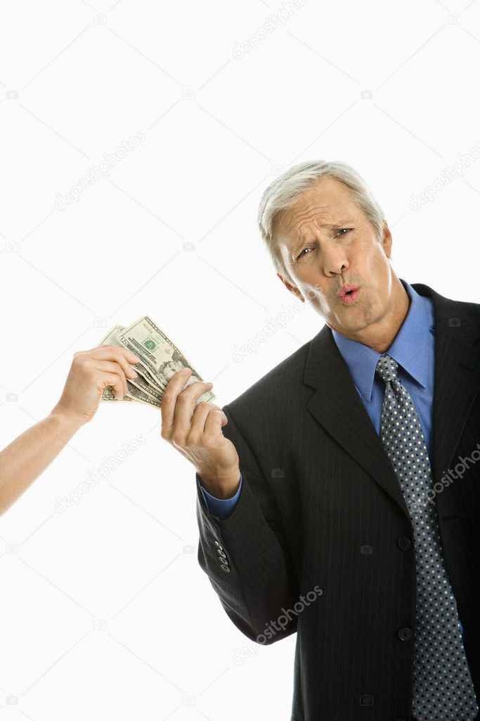 Woman holding money with Caucasian middle aged businessman making facial expression. — Stock Photo #9305394