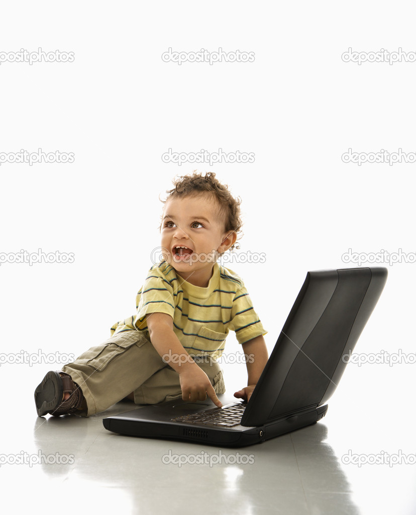 Happy African American toddler boy on laptop computer looking to side. — Stock Photo #9305590