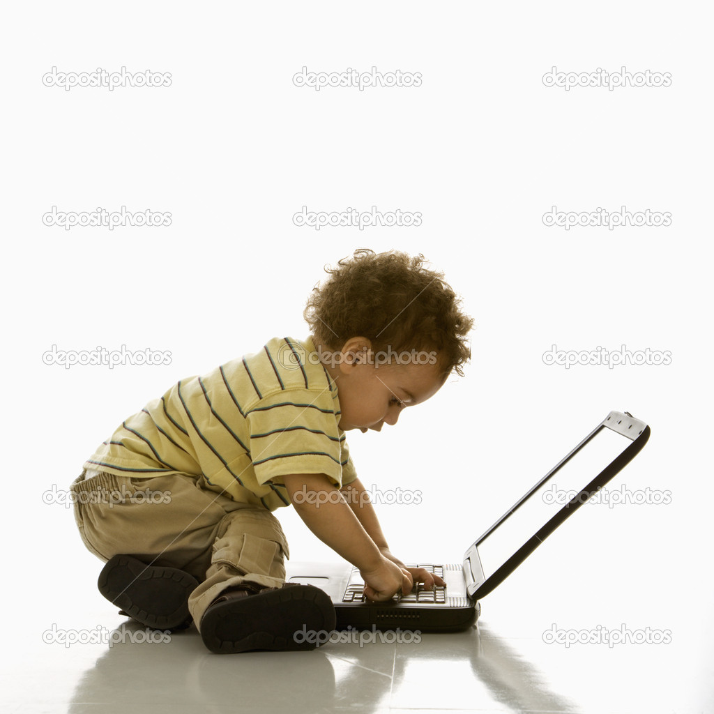 Side view of African American toddler boy using laptop computer. — Stock Photo #9305591