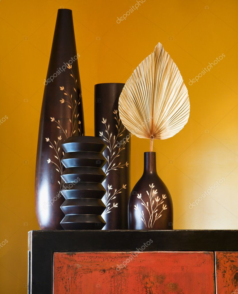 Still life of interior with Asian vases on dresser.  Stock Photo #9306729