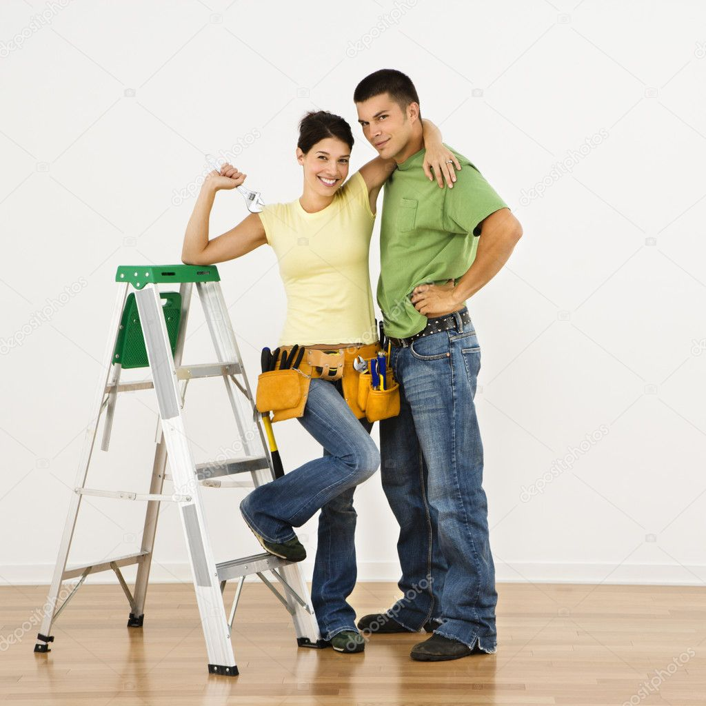 Couple with tools and ladder standing in home smiling. — Stock Photo #9306923
