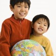 Boys holding globe — Stock Photo