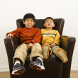 Asian brothers in chair — Zdjęcie stockowe