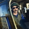 Male pilot in helicopter. - Stock Photo