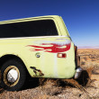 Car with Flames Parked in Desert - Stock Photo