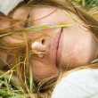 Female resting in grass. — Stock Photo