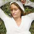 Woman lying in grass. — Stock Photo