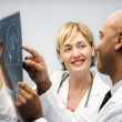 Physicians analyzing xray. - Stock Photo